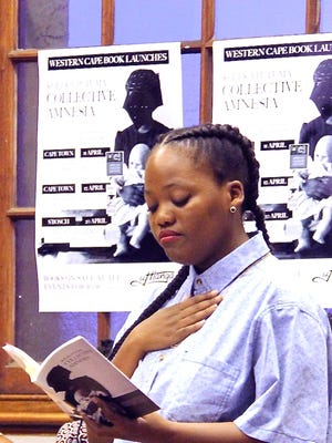 """South African performance poet Koleka Putuma reads her work at the launch of her book, """"Collective Amnesia,"""" in Stellenbosch, outside of Cape Town, in April 2017."""