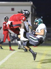 Zach Sessa makes the catch for Venice in the end zone for the touchdown in front of South Fort Myers player Riley Ware. South Fort Myers battled Venice in their Class 7A-12 Playoff game Friday night, November 13, 2015, at South Fort Myers.