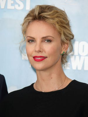 Charlize Theron promoting 'A Million Ways To Die In The West' in London on May 27.