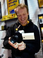 Kodak representative Josh Robertson demonstrates Kodak's