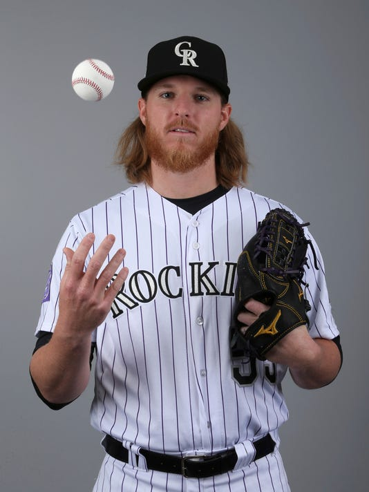 FILE - This is a 2018 file photo showing Jon Gray of the Colorado Rockies baseball team. Gray will be back on the mound Thursday, March 29, when the Rockies and Diamondbacks _ two teams with sights son the Dodgers in the NL West _ open their seasons. (AP Photo/Ralph Freso, File)