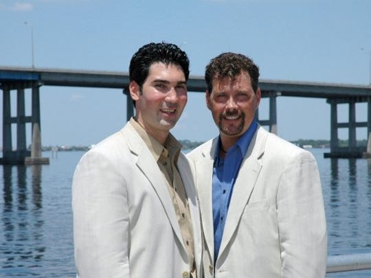 David Plazas, left, and Darren Bradford on their commitment ceremony on May 20, 2006.
