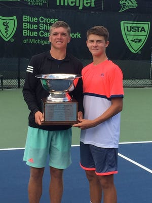 John McNally and J.J. Wolf display their U.S. National Junior Doubles Championship trophy.