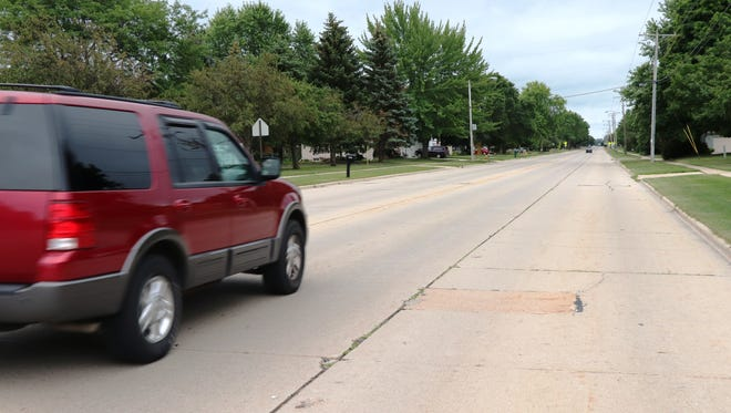 Neenah traffic engineer James Merten recognizes that Tullar Road is in need of additional pavement markings to guide traffic.