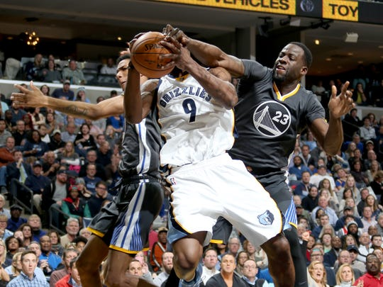 Memphis Grizzlies Tony Allen elevates to shoot defended by Golden State Warriors Patrick McCaw, left, and Draymond Green. Green was charged with a foul on the play.