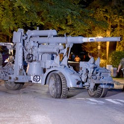 In this July 2, 2015 picture a  WWII era flak canon is prepared to be  transported from from a residential property in Heikendorf, Germany. Authorities have seized a 45-ton Panther tank, a flak canon and multiple other World War II-era military weapons in a raid on a 78-year-old collector's storage facility in northern Germany.