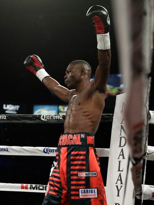 Guillermo Rigondeaux celebrates his first-round knockout of Moises Flores.