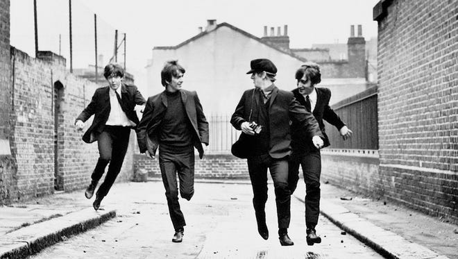 "Paul McCartney, left, George Harrison, Ringo Starr, and John Lennon in a scene from the 1964 motion picture ""A Hard Day's Night."""
