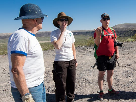 Justina Thorsen, of BLM and Benjamin Gabriel of The Friends of the Organ Mountains-Desert Peaks group give cleanup instructions to volunteers.