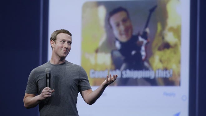 Facebook CEO Mark Zuckerberg gestures while delivering the keynote address at the Facebook F8 Developer Conference in March.