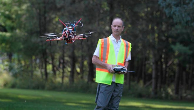 UAV Imaging Services owner Martin Lachance operates a Quad Flip FPV Pro drone at his Mendon home. He was the first in the area to secure an exemption from the Federal Aviation Administrator to fly commercially.