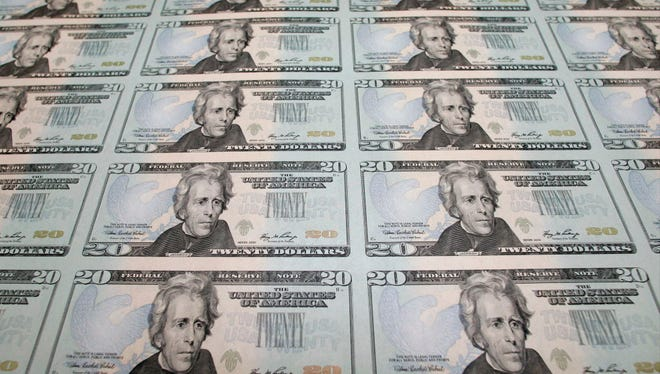 In this file photo taken Oct. 23, 2006, the new Series 2006 $20 currency notes are seen at the Bureau of Engraving and Printing in Washington.