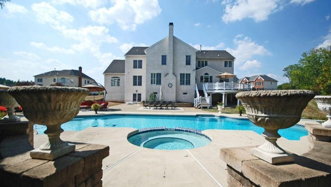 This four-bedroom Raritan Township home has a private pool and spa in the backyard.