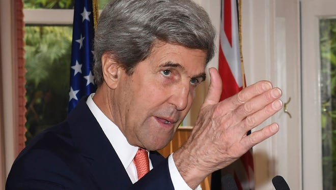 Secretary of State John Kerry speaks during a news conference with New Zealand Prime Minister John Key at Premier House in Wellington, New Zealand Sunday, Nov. 13, 2016.