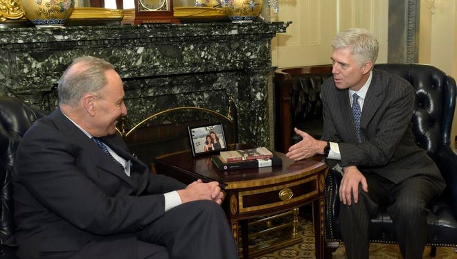 Senate Minority Leader Charles Schumer of N.Y. meets with Supreme Court nominee Neil Gorsuch on Capitol Hill in Washington, Tuesday, Feb. 7, 2017.