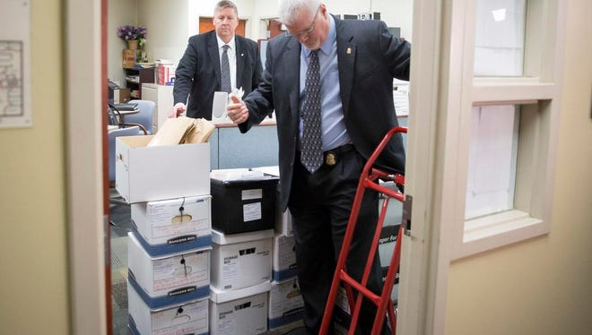 FBI agents execute a search warrant at Muncie City Hall  on Jan. 5 inside the building commissioners office.