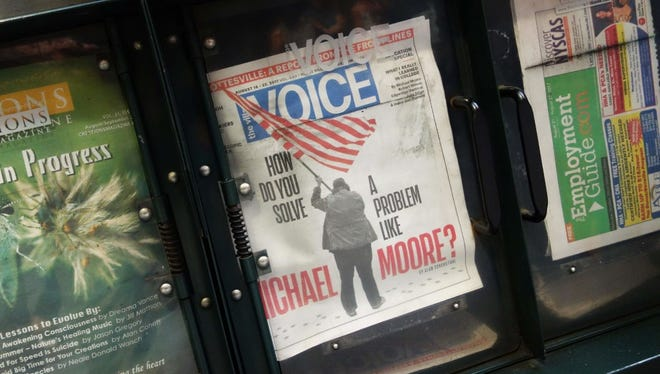 The Village Voice is on sale at a newsstand on 42nd Street on August 22, 2017 in New York.