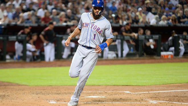 Jun 16, 2018; Phoenix, AZ, USA; New York Mets shortstop Amed Rosario (1) scores a run after a wild pitch by the Arizona Diamondbacks during the third inning at Chase Field.