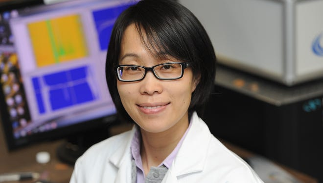 Materials science researcher Jier Huang will work on a National Science Foundation solar energy project in her lab at Marquette University as well as at Argonne National Laboratory near Chicago.