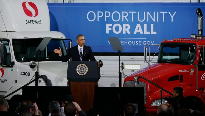 President Obama speaks at a distribution center for Safeway stores in Upper Marlboro, Md., on Feb. 18. The president said having a more fuel-efficient truck fleet will boost the economy and help combat climate change.