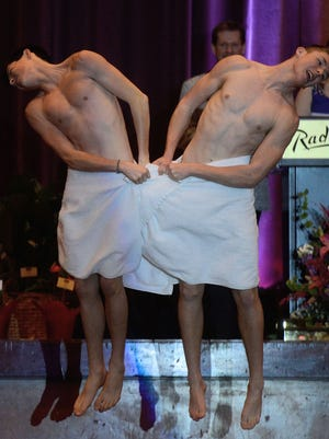 Mr. Notre Dame Academy Greg Young, right, and friend Nick Robinson do a comedic dance routine where they only cover themselves in towels during the Mr. Titletown competition Sunday at the Radisson Hotel and Conference Center in Ashwaubenon.