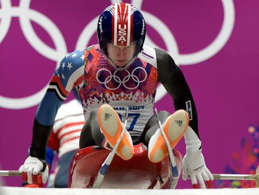 Adian Kelly (USA) pushes off on his his second run at the men's luge singles event.