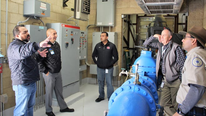 Grupo CARSO hydrologists from Ciudad Juárez tour an LCU wellhouse in Las Cruces with Jorge A. Garcia, LCU director; Pascual Rodriguez, water production supervisor; and Tony Parra, SCADA supervisor, during a visit to compare technologies and share information.