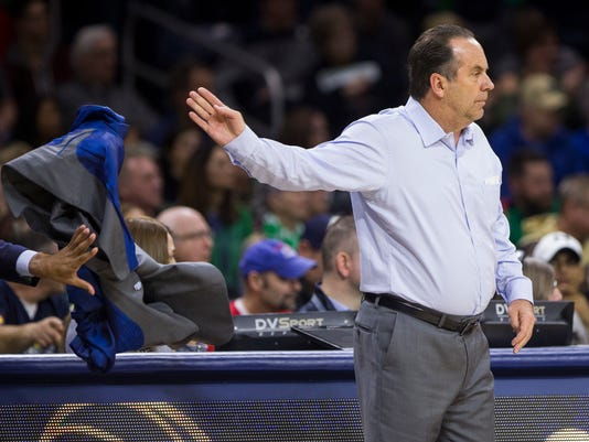 Notre Dame head coach Mike Brey tosses his coat during the first half of an NCAA college basketball game against Virginia Tech Saturday, Jan. 27, 2018, in South Bend, Ind. (AP Photo/Robert Franklin)