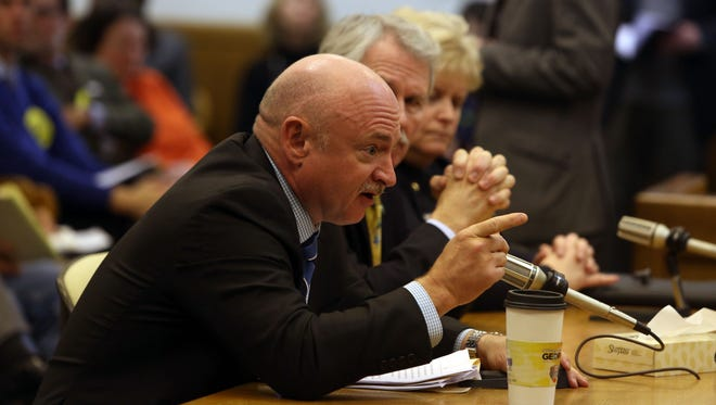 Retired Navy Capt. Mark Kelly testifies Feb. 6, 2014, in front of the Oregon Senate Judiciary Committee in Salem, Ore. on a bill to expand background checks for firearms sales.
