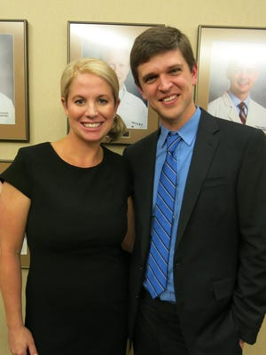 Kelly and Dr. Peter Campbell at reception.