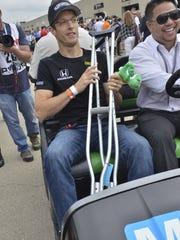 SŽbastien Bourdais, injured during a qualification run, rides around the track prior to the Indy 500 May 28, 2017.