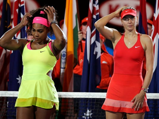 Winner Serena Williams of the U.S., left, and  runner-up Maria Sharapova of Russia, right, wait for the trophy presentation after the women's singles final at the Australian Open tennis championship in Melbourne, Australia, Saturday, Jan. 31, 2015. (AP Photo/Vincent Thian)