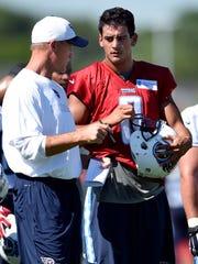 Titans head coach Ken Whisenhunt talks with quarterback Marcus Mariota (8) during practice at St. Thomas Sports Park Friday July 31, 2015, in Nashville, Tenn.