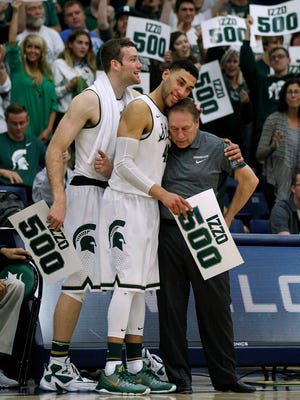 Michigan State coach Tom Izzo, right, gets a hug from guard Denzel Valentine, who is next to forward Matt Costello, after Izzo's 500th career win, during an NCAA college basketball game, a 99-68 victory over Boston College in the quarterfinals of the Wooden Legacy tournament in Fullerton, Calif., Thursday, Nov. 26, 2015.