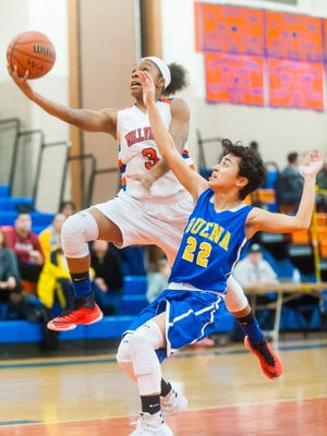 Millville guard India Parker (3) goes up for a shot against Buena at Millville Senior High School on Monday, January 9.
