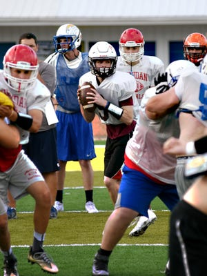 Matthew Stewart looks for an open receiver during Monday's Muskingum Valley All-Star football practice. Stewart set a pair of school records for John Glenn as a senior.