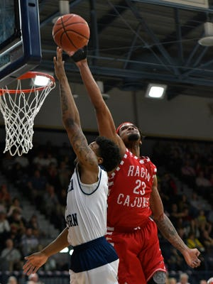 UL's JaKeenan Gant (23) blocks a shot attempt by Georgia Southern guard Tookie Brown on a second half drive as the Ragin' Cajuns take on the Eagles Saturday Feb. 10, 2018.
