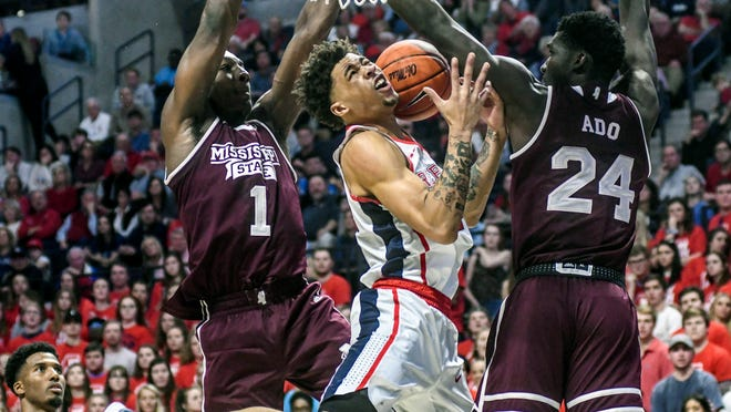 Mississippi guard Blake Hinson (0) loses the ball between Mississippi State forward Reggie Perry (1) and forward Abdul Ado (24) during the first half of an NCAA college basketball game in Oxford, Miss., Saturday, Feb. 2, 2019. (Bruce Newman/The Oxford Eagle via AP)