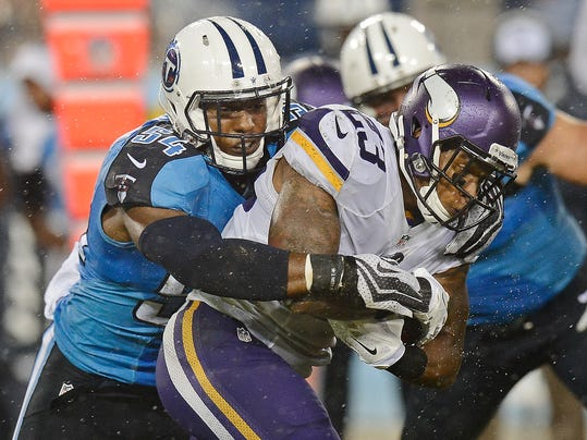 Minnesota Vikings running back Joe Banyard (23) is stopped by Tennessee Titans linebacker Avery Williamson (54) in the second quarter of a preseason NFL football game Thursday, Aug. 28, 2014, in Nashville, Tenn. (AP Photo/Mark Zaleski)