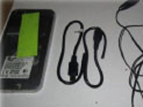 Images provided by the Florida Department of Corrections show the contents of a package dropped by a drone at a Panhandle prison.