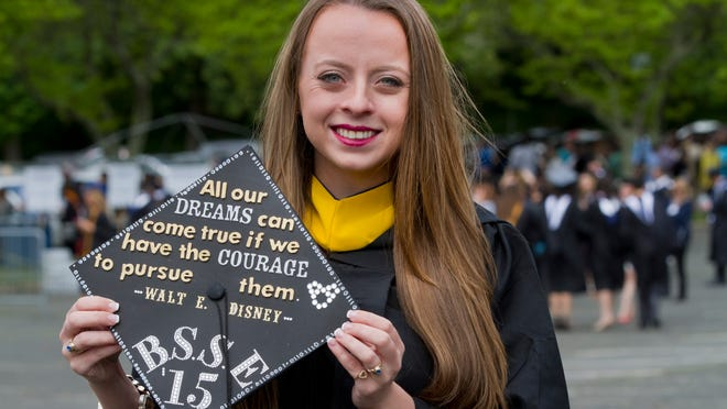 Courtney Locke, a senior engineering major who has a job waiting for her, attends Wednesday's Monmouth University commencement at PNC Bank Arts Center in Holmdel.