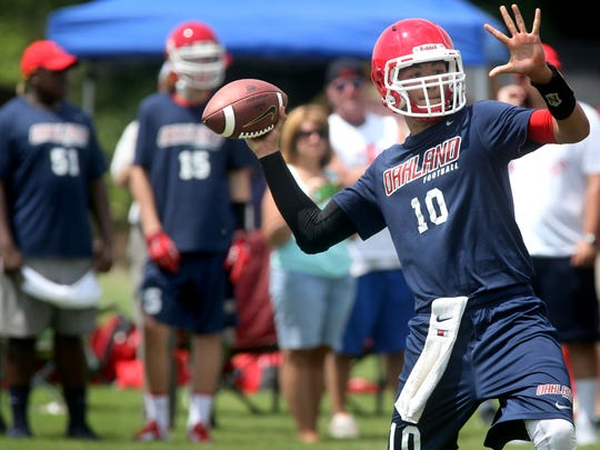 Oakland's quarterback  Christian Haffner passes the ball during the quaterfinal game aginst Smyrna in Riverdale's high school  7-on-7 prep football tournament on Thursday, July 10, 2014. Oakland  lost to Father Ryan in the Championship game.