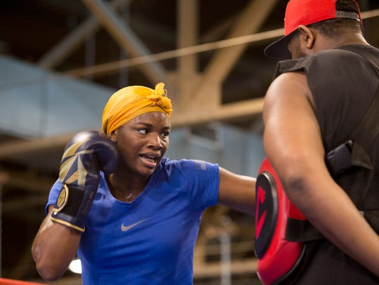 Claressa Shields practices with Charlie Edwards on