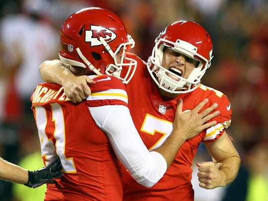 Kansas City Chiefs kicker Harrison Butker (7) celebrates with long snapper James Winchester (41) after kicking a field goal against the Washington Redskins in the second half at Arrowhead Stadium.