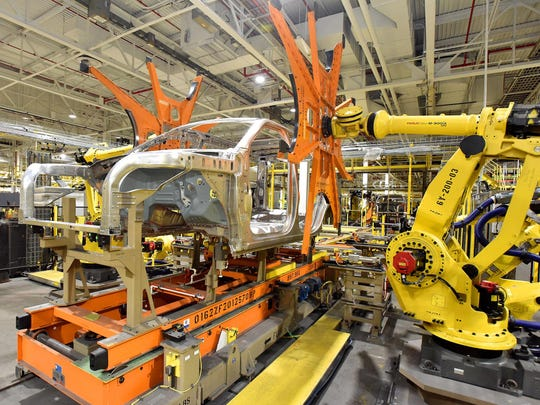 Robotic arms hoist the body of a 2018 Ford Expedition or a 2018 Lincoln Navigator at the Kentucky Truck Plant.