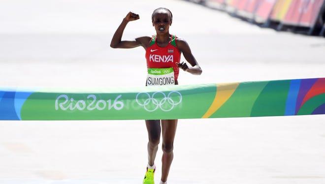 Jemima Jelagat Sumgong of Kenya celebrates her victory in the women's marathon.