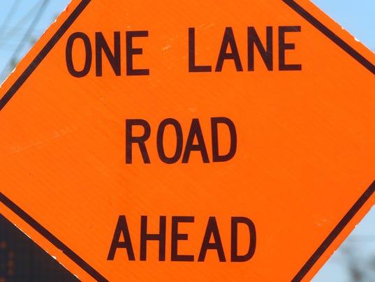 636592294958098483-Sign-One-Lane-Road-Ahead.JPG