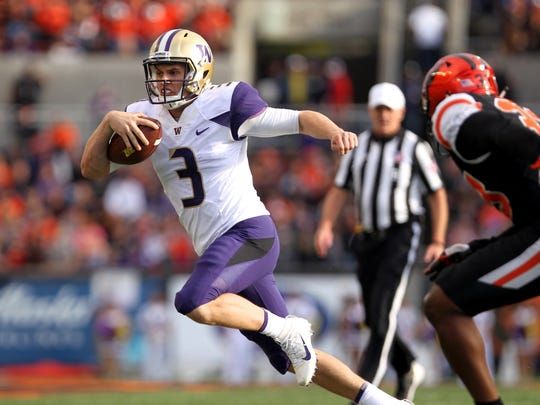 Washington quarterback Jake Browning (3) runs upfield Oregon State Beavers in the first half of Saturday's game.