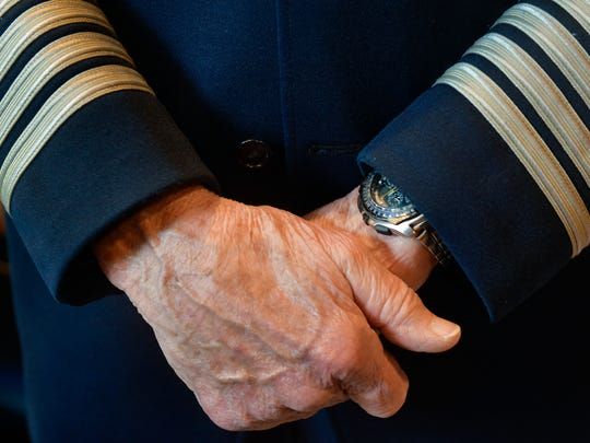 Retired American Airlines pilot Andy Anderson, 85 crosses his arms Wednesday, April 6, as he talks wearing his old uniform.
