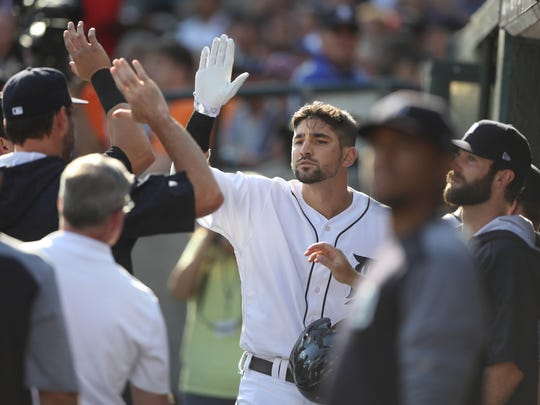 Tigers third baseman Nick Castellanos high-fives his teammates after his homer during the first inning on Saturday, July 15, 2017, at Comerica Park.